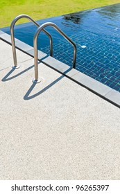 Blue swimming pool with sand washed flooring summer vacation