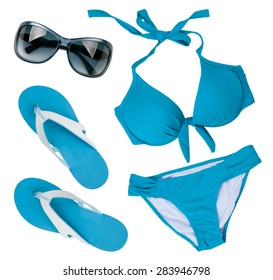 Blue swimsuit, sunglasses and flip flops isolated on white