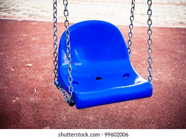 Blue swing on a playground