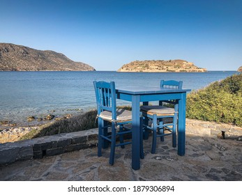 Blue Table and Chair in front of Spinalonga