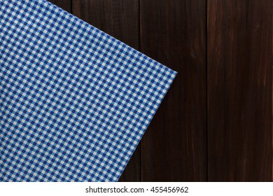 blue tablecloth on dark wooden background