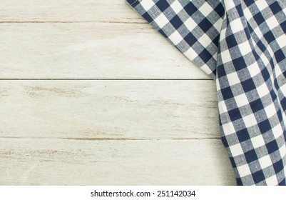 Blue tablecloth on white wooden table.