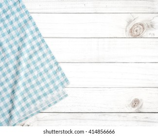 Blue tablecloth on white wooden table with copy space.