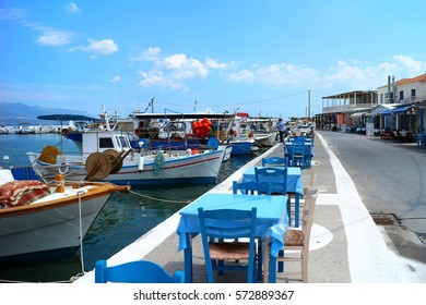 Blue tables and chairs of a seaside taverna in Elafonisos island village, Peloponnese