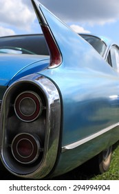 Blue tail fin and brake lights from a vintage american car.