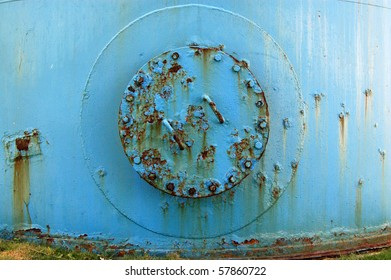 Blue tank Detail of a hatch on the side of a large blue storage tank.