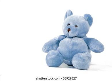 Blue teddy bear against a white background
