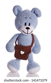 blue teddy bear with brown school bag