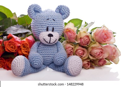 blue teddy bear with pink roses