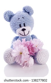 blue teddy bear stuffed animal with pink blossom
