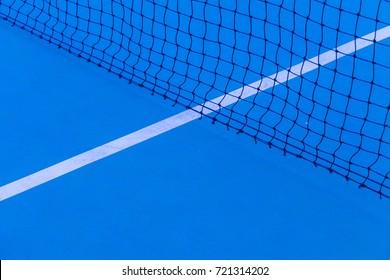Blue tennis court surface, sport background. Detail of a tennis court Tennis court with net background.