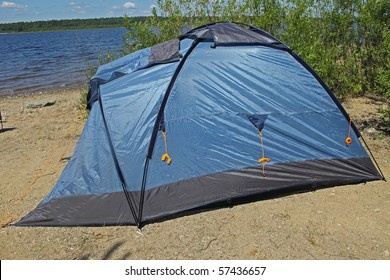Blue tent on the bank of lake