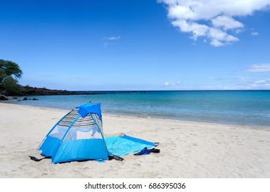 Blue tent on  Kaunaoa beach, Big Island, Hawaii