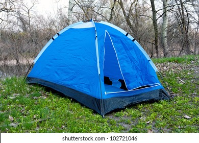 blue tent in spring forest