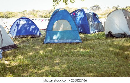 Blue tents in the campsite at a music festival