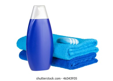 blue terry towels, shampoo and soap on white background. Isolated.
