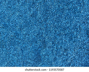 blue texture of the pebbles, colored background stones. Pile of stones, close-up of the blue pebbles, blue rocks for background or texture
