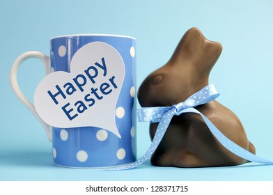 Blue theme polka dot breakfast coffee mug with chocolate bunny rabbit and heart shape message saying Happy Easter.
