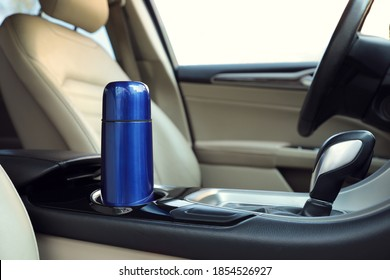 Blue thermos in holder inside of car