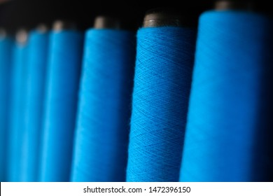 Blue thread made of cotton, Hand made from farmers After harvest season, Dye with indigo made it blue. Beautiful color from nature, blue spools of sewing thread. Colored thread for sewing