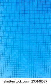 blue tile floor under water of swimming pool texture