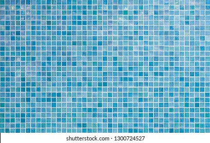 blue tile wall with square small mosaic tiles texture background