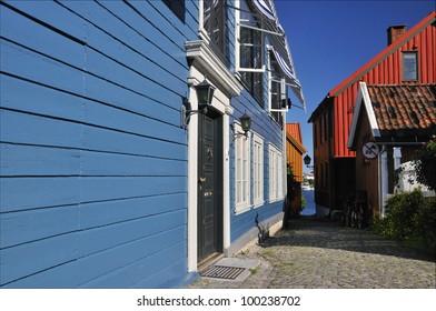 Blue timberhouses in Larvik, Norway, summer time