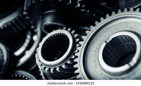Blue tint black industrial gears and cogs on black background, banner