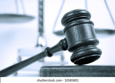 Blue tinted monotone image of a gavel and scales of justice