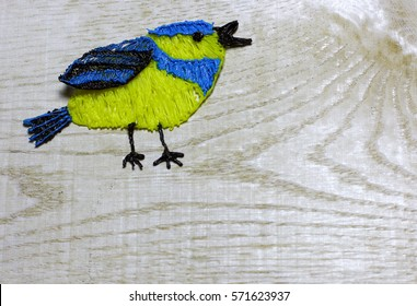 Blue tit on light wooden background. Spring bird. Child`s hand made draw with 3D printing pen. Love card for Valentine's day. Concept with big copyspase for hand crafts or DIY illustration.