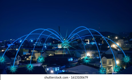Blue tone city the wireless network and connection technology concept.communication with smart city and big data. The internet of thing.Bangkok city background at night in Thailand.