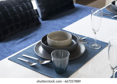 blue tone style of plate setting on dining table