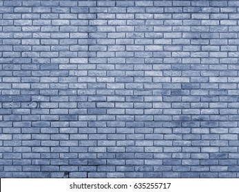 blue toned brick wall with repeating pattern