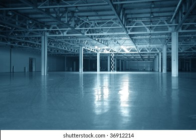 Blue toned empty dark storehouse with columns