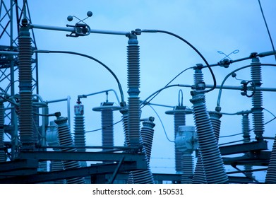 blue toned photo of a power station transformers