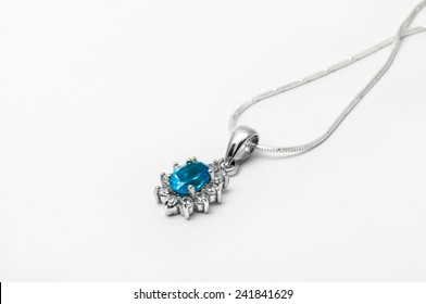 blue topaz necklace with white background