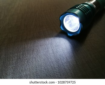 blue torclight , flashlight with the light shining.