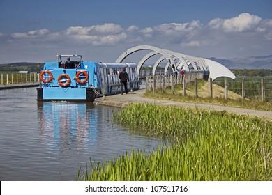 Blue tourist barge waiting to descend on the Falkirk Wheel. Falkirk, Central Scotland, UK.