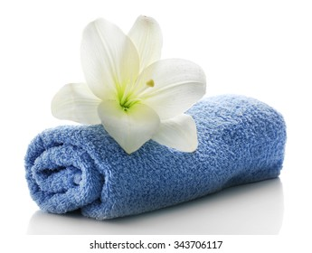 Blue towel with flower isolated on white background