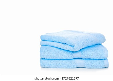 Blue towel isolated on white background with copy space