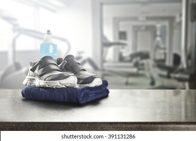 blue towel and shoes and gym place
