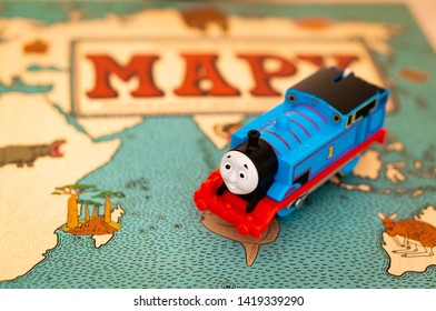 Blue toy train from the Thomas and Friends series on a Polish book cover with map on circa June 2019 in Poznan, Poland.