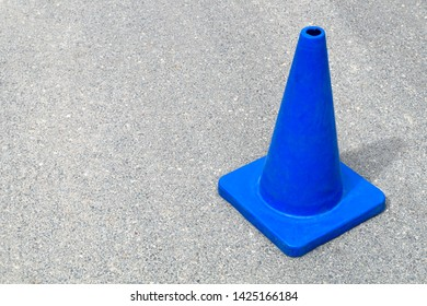 blue traffic cone under construction web site sign