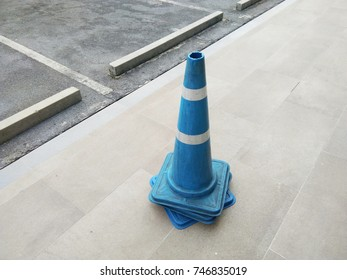 Blue traffic cones on the street