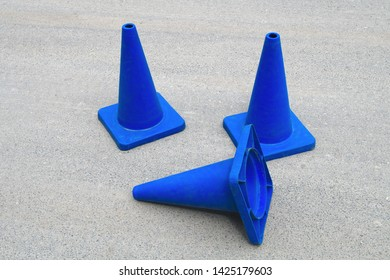 blue traffic cones under construction web site sign