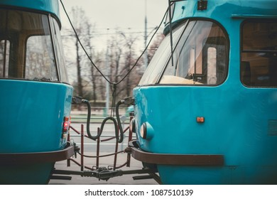 Blue tram rides around the city in spring