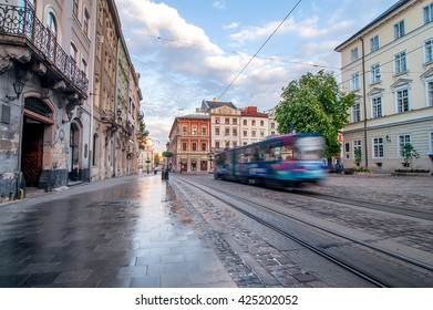 Blue tram rides on the morning  old european city.
