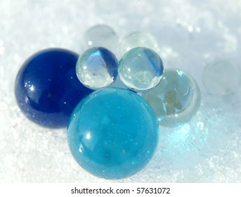 Blue and transparent balls on a snow in the winter