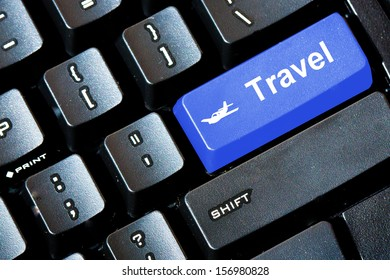 Blue TRAVEL button on a computer keyboard