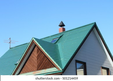 Of blue triangle roof house